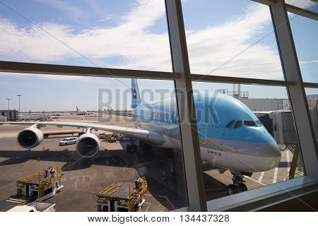 NEW YORK - APRIL 06, 2016: Korean Air A380 docked in JFK Airport. Korean Air, is the largest airline in South Korea based on fleet size, international destinations and international flights.