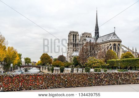 PARIS FRANCE - OCTOBER 23 2015 : Pont de l Archeveche with love padlocks the bridge near Notre Dame de Paris Cathedral