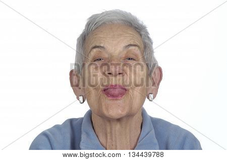 old woman sticking out her tongue on white background