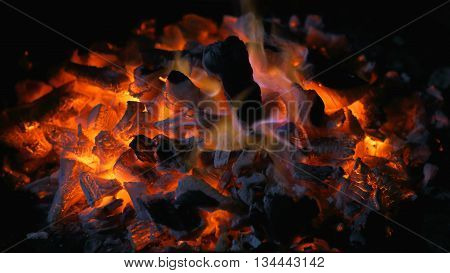 Burning coal or charcoal coals in barbeque