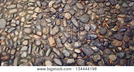 Paved Stone Walkway. Aged photo. Wet street paving stone. Cobblestone street. Old pavement useful as a background Varenna Lake Como Italy.