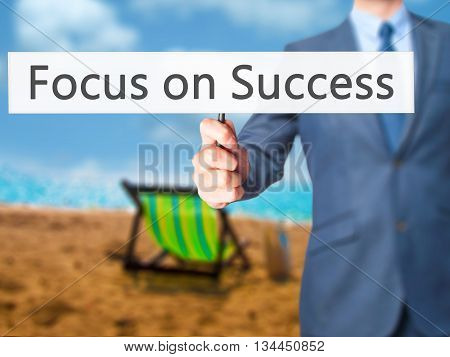 Focus On Success  - Businessman Hand Holding Sign