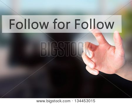Follow For Follow - Hand Pressing A Button On Blurred Background Concept On Visual Screen.