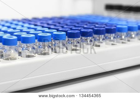 Rows Of Glass Vials In The Tray Automatic Liquid Dispenser.