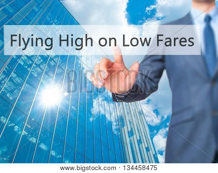 Flying High On Low Fares - Businessman Hand Pressing Button On Touch Screen Interface.
