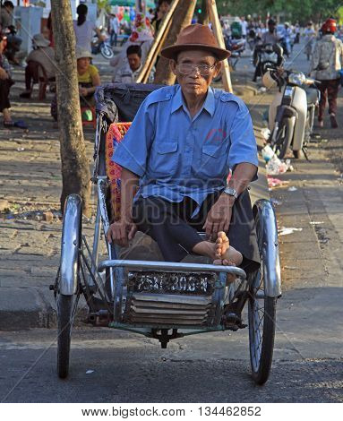 Man Is Sitting In A Cart On Street In Hue, Vietnam