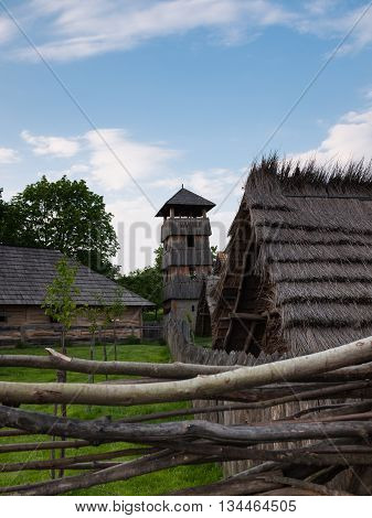 Wooden tower and shelter inside reconstruction of Slavic settlement