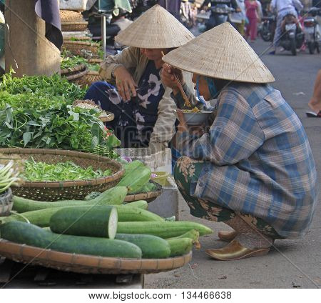 Women Are Eating On Street Market In Hue, Vietnam