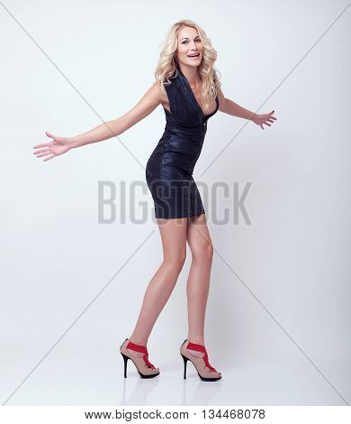 attractive slim blonde girl pose in black clothes