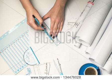Architect working on blueprint. Architects workplace - architectural project blueprints ruler and divider compass. Construction concept. Engineering tools. Top view poster