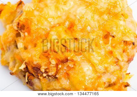 Chicken rissole covered with cheese. Macro. Photo can be used as a whole background.