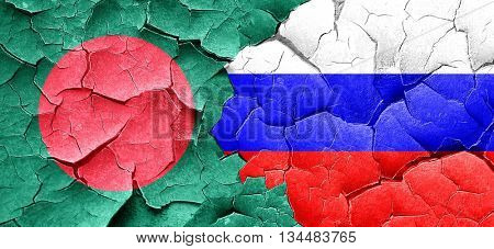 Bangladesh flag with Russia flag on a grunge cracked wall