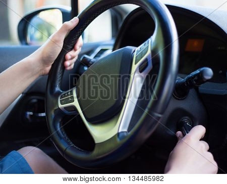 Driver's Hand Holding Car Key For Starting The Car