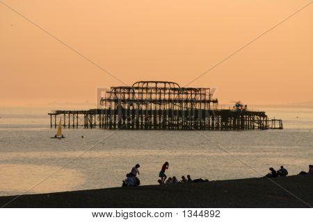 Orange sunset sky over pier