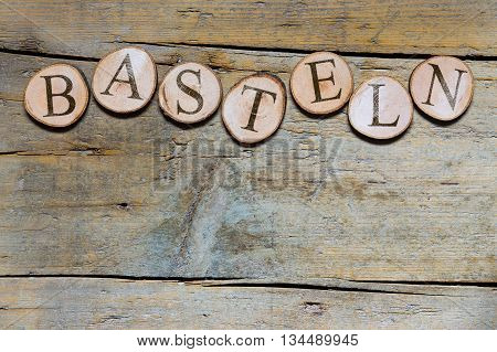 Wooden Slices On Wooden Table, German Word, Concept Handicrafts