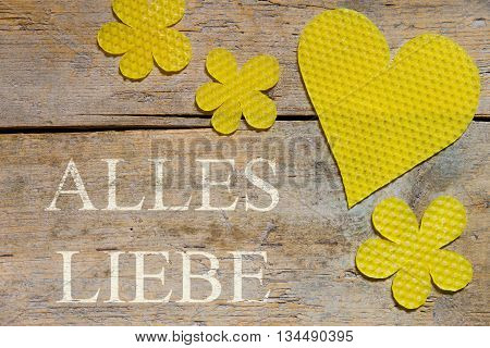 Beeswax, Heart And Flowers On Wooden Table, German Words, Love