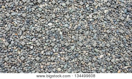 The Close Up Rock Texture Background With Plastic Net Prevent Slip