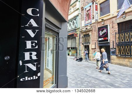 LIVERPOOL, UK. JUNE 09, 2016: Entrance to The Cavern Club, on Mathew Street, where The Beatles played their first concert, with pedestrian passing in the background.