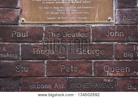 LIVERPOOL, UK. JUNE 09, 2016: Wall of fame plaque at entrance to The Cavern Club, where The Beatles played their first concert. In detail, the Beatle's names.