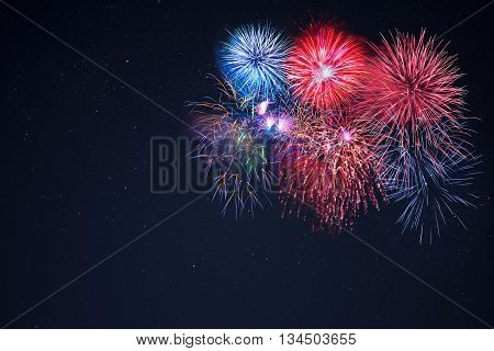 Beautiful celebration fireworks over starry sky copy space. Independence Day New Year holidays salute. 4th of July beautiful fireworks. Holidays background.