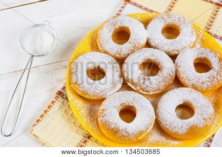 Homemade sweet donuts with caster sugar. Hanukkah homemade donuts. Sweet dessert. Sweet pastry doughnuts.