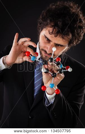 Businessman Building A Tnt Molecular Structure