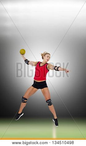 Female athlete with elbow pad throwing handball against digital image of handball field indoor