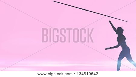 Profile view of sportswoman is practising javelin throw against pink background