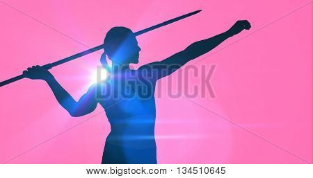 Front view of sportswoman practising javelin throw against pink background