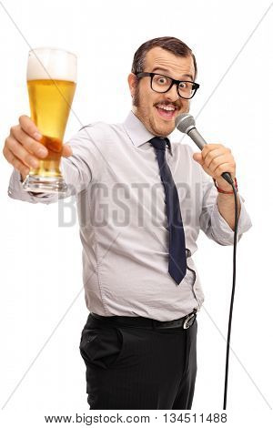 Vertical shot of a joyful young man singing karaoke on a microphone and holding a pint of beer isolated on white background