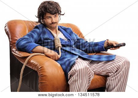 Bored young man watching TV and changing channels with a rope around his neck isolated on white background