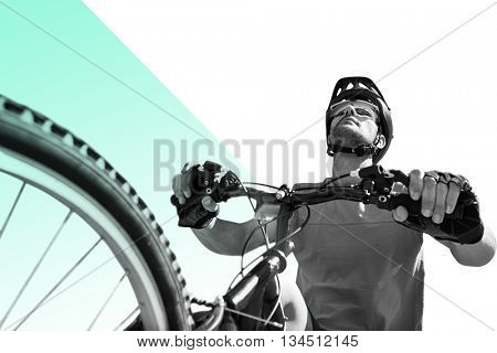 Man cycling with mountain bike against different colors