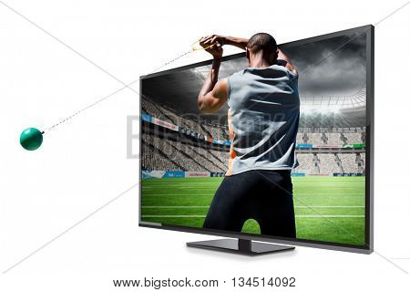 Rear view of sportsman practising hammer throw against rugby stadium