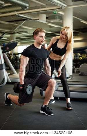 Fitness couple making exercies in a gym