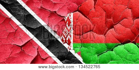 Trinidad and tobago flag with Belarus flag on a grunge cracked w