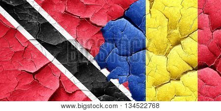 Trinidad and tobago flag with Romania flag on a grunge cracked w
