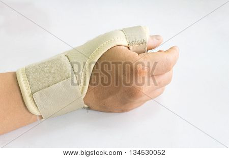 Elastic wrist support brace band wrap on hand to relieve pain selective focus