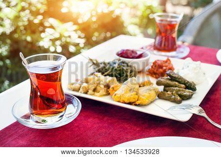 Turkish Tea And Meze In Restaurant