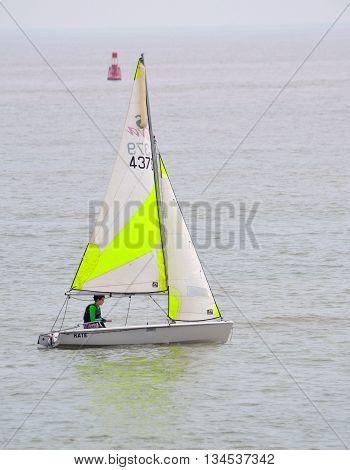 FELIXSTOWE, SUFFOLK, ENGLAND - JUNE 11, 2016: Colourful Sailing Dinghies on the North Sea  at Felixstowe Suffolk England.