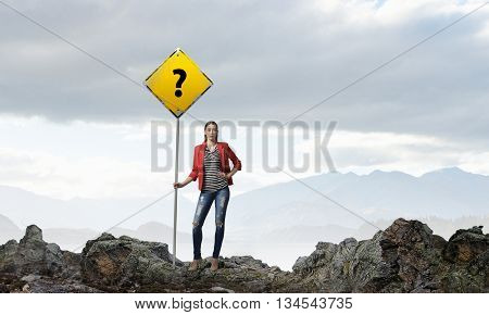Pretty girl with roadsign
