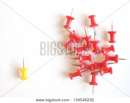 thumbtacks pinned arrange to symbolize on white background to be different or leadership like boss with copy space (able to imply to various meaning)