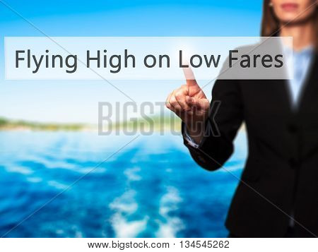 Flying High On Low Fares - Businesswoman Hand Pressing Button On Touch Screen Interface.