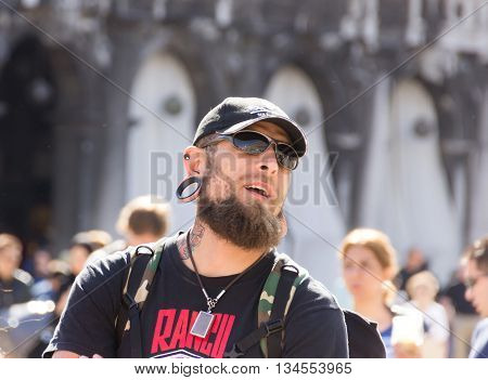 Venice Italy - September 28 2015: Man with a big earring looking at Dogee Palace on San Marco Square Venice Italy