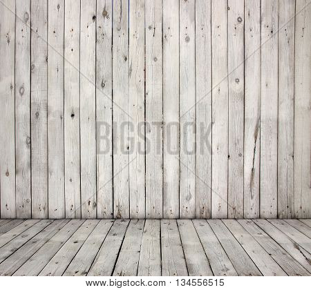 Old wooden wall and dirty wood floor.