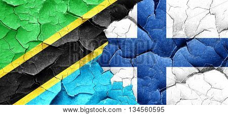 Tanzanian flag with Finland flag on a grunge cracked wall