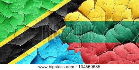 Tanzanian flag with Lithuania flag on a grunge cracked wall