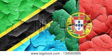 Tanzanian flag with Portugal flag on a grunge cracked wall