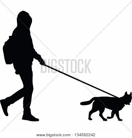 man with backpack and dog are walking