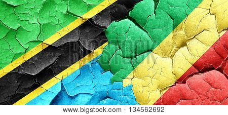 Tanzanian flag with congo flag on a grunge cracked wall