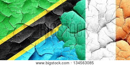 Tanzanian flag with Ireland flag on a grunge cracked wall